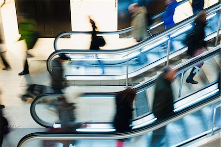 shopping mall - High angle view of people using escalator in shopping mall Stock Photo - Premium Royalty-Free, Code: 698-07158462