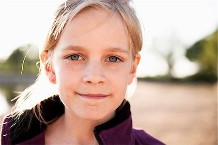 preteen  smile  one  alone - Portrait of girl smiling outdoors Stock Photo - Premium Royalty-Free, Code: 698-07158480