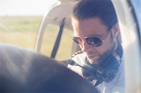 dark glasses - Air pilot in cockpit of propeller aeroplane Stock Photo - Premium Royalty-Free, Code: 698-07158497