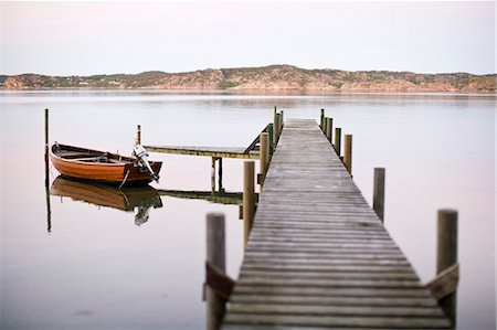 Motorboat moored at pier Stock Photo - Premium Royalty-Free, Code: 698-07158524