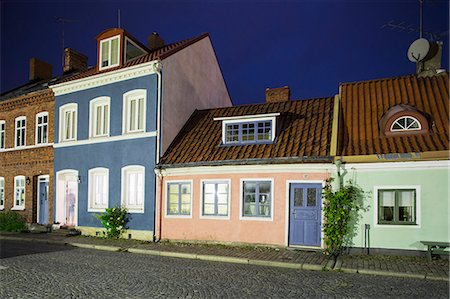 Row of houses against sky Stock Photo - Premium Royalty-Free, Code: 698-07158528
