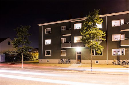 Light trails on street in front of residential building Stock Photo - Premium Royalty-Free, Code: 698-07158529