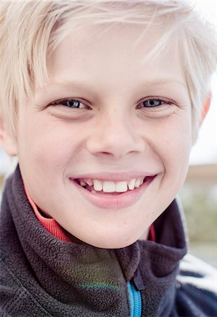 european - Close-up portrait of boy smiling Stock Photo - Premium Royalty-Free, Code: 698-07158551