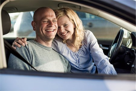 Portrait of happy woman with man in car Stock Photo - Premium Royalty-Free, Code: 698-07158577