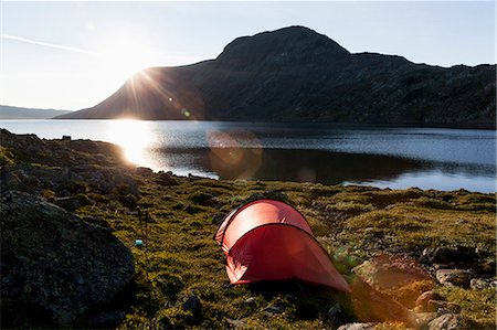 Tent at lakeshore against mountains Stock Photo - Premium Royalty-Free, Code: 698-07158629