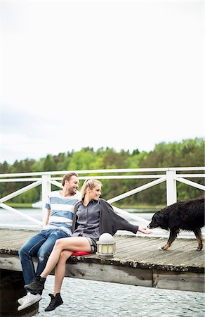 Couple with dog on pier Stock Photo - Premium Royalty-Free, Code: 698-07158671