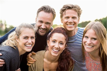 Portrait of happy friends outdoors Stock Photo - Premium Royalty-Free, Code: 698-07158692