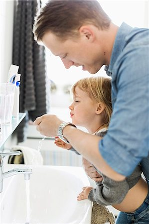Father and daughter at bathroom sink Stock Photo - Premium Royalty-Free, Code: 698-07158720