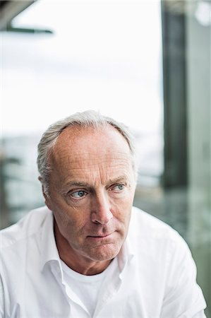 Pensive mature businessman looking away Stock Photo - Premium Royalty-Free, Code: 698-07158835