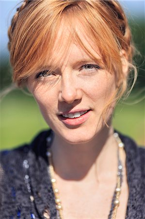 stockholm - Portrait of redhead woman in park Stock Photo - Premium Royalty-Free, Code: 698-07158869