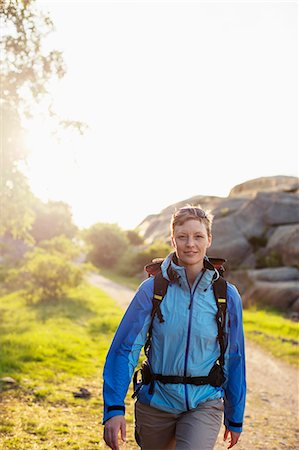 Portrait of female backpacker hiking outdoors Stock Photo - Premium Royalty-Free, Code: 698-07439346