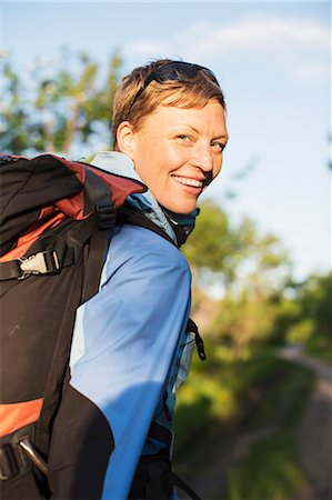 Portrait of female hiker smiling outdoors Stock Photo - Premium Royalty-Free, Code: 698-07439343