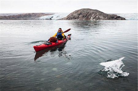 Mature man kayaking on sea Stock Photo - Premium Royalty-Free, Code: 698-07439485