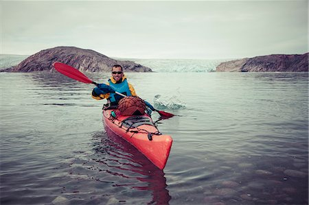 Portrait of happy mature man kayaking on sea Stock Photo - Premium Royalty-Free, Code: 698-07439486