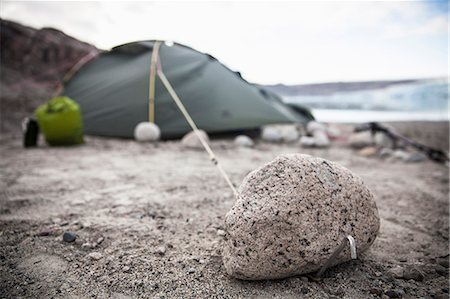 View of stone with camping tent in background Stock Photo - Premium Royalty-Free, Code: 698-07439487