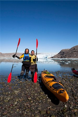 Full length portrait of mature women holding oars by kayak at lakeshore Stock Photo - Premium Royalty-Free, Code: 698-07439488