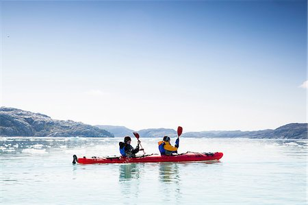 People kayaking on sea against clear sky Stock Photo - Premium Royalty-Free, Code: 698-07439489