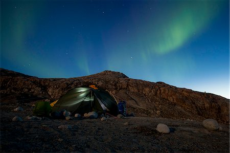 Tent with northern green lights at night Stock Photo - Premium Royalty-Free, Code: 698-07439494