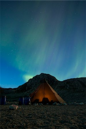 Northern lights or Aurora Borealis over tent at night Stock Photo - Premium Royalty-Free, Code: 698-07439495