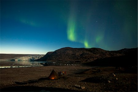 Northern green lights or Aurora Borealis over tent at night Stock Photo - Premium Royalty-Free, Code: 698-07439496