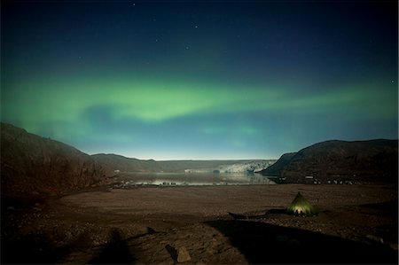 Northern green lights or Aurora Borealis over tent Stock Photo - Premium Royalty-Free, Code: 698-07439497