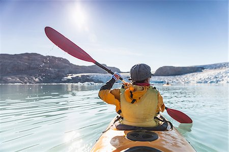 Rear view of mature woman kayaking on sea Stock Photo - Premium Royalty-Free, Code: 698-07439492