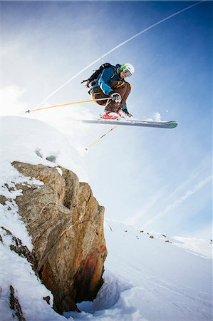 Full length of free ride skier in mid air against sky Stock Photo - Premium Royalty-Free, Code: 698-07439504