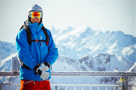 Portrait of happy man in ski clothing standing against mountain Stock Photo - Premium Royalty-Free, Code: 698-07439505