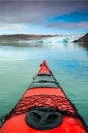 Red kayak bow on lake Stock Photo - Premium Royalty-Free, Code: 698-07439500