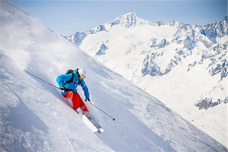 Full length of man skiing on mountain slope Stock Photo - Premium Royalty-Free, Code: 698-07439502