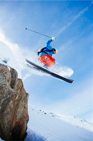 Low angle view of mid adult man skiing against sky Stock Photo - Premium Royalty-Free, Code: 698-07439503