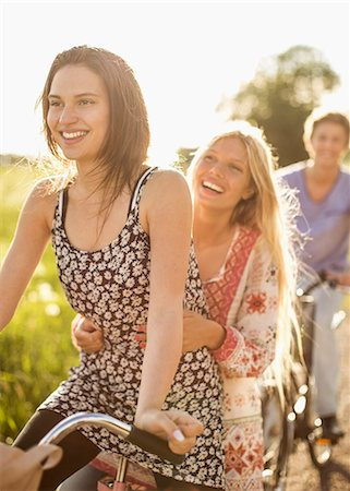 Happy friends enjoying bicycle ride at countryside Stock Photo - Premium Royalty-Free, Code: 698-07439543
