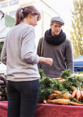 sold sign - Young man buying vegetables at market stall Stock Photo - Premium Royalty-Free, Code: 698-07439643