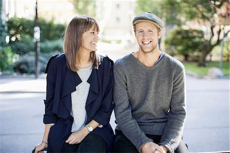 stockholm - Happy couple sitting outdoors Stock Photo - Premium Royalty-Free, Code: 698-07439664