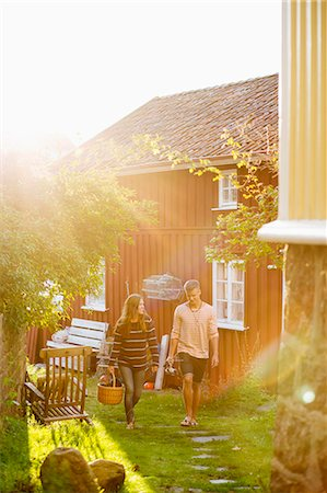 Full length couple walking together in yard Stock Photo - Premium Royalty-Free, Code: 698-07439684