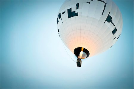Low angle view of hot air balloon against clear blue sky Stock Photo - Premium Royalty-Free, Code: 698-07439698
