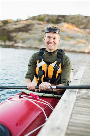sports - Portrait of happy man kayaking in river Stock Photo - Premium Royalty-Free, Code: 698-07439708
