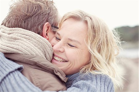 passion - Happy woman embracing man outdoors Stock Photo - Premium Royalty-Free, Code: 698-07439733