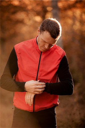 stop watch - Man in sportswear checking time in forest Stock Photo - Premium Royalty-Free, Code: 698-07439744
