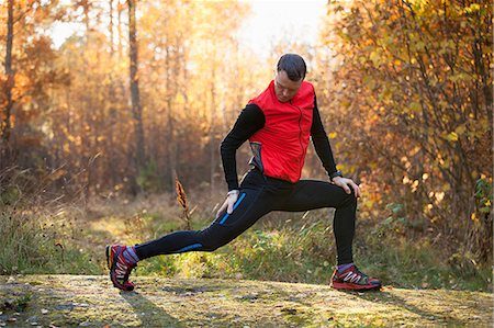 stretching (people exercising) - Full length of man doing stretching exercise in forest Stock Photo - Premium Royalty-Free, Code: 698-07439742