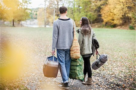 season - Rear view of couple carrying luggage while camping in forest Stock Photo - Premium Royalty-Free, Code: 698-07587735