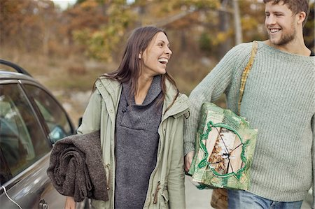 Couple carrying camping equipment by car Stock Photo - Premium Royalty-Free, Code: 698-07587733