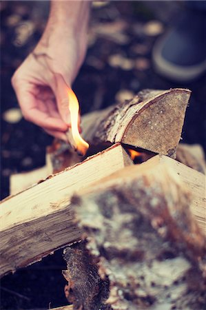 flame - Man's hand igniting bonfire Stock Photo - Premium Royalty-Free, Code: 698-07587747