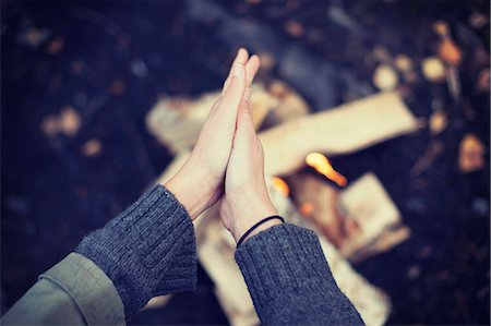 season - Cropped image of woman rubbing hands over campfire Stock Photo - Premium Royalty-Free, Code: 698-07587750
