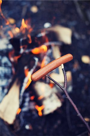 flame - Sausage cooking on campfire Stock Photo - Premium Royalty-Free, Code: 698-07587767