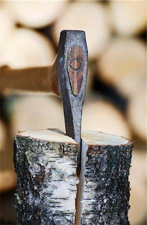 Axe cutting firewood Stock Photo - Premium Royalty-Free, Code: 698-07587796