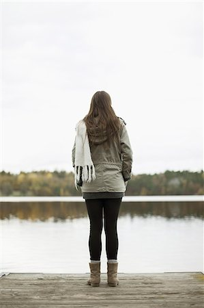 Rear view of woman standing on pier Stock Photo - Premium Royalty-Free, Code: 698-07587790