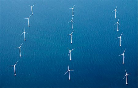 Rows of wind turbines in blue sea Stock Photo - Premium Royalty-Free, Code: 698-07587810