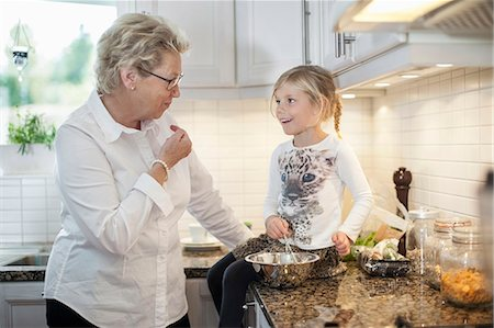 Grandmother and granddaughter preparing food in kitchen Stock Photo - Premium Royalty-Free, Code: 698-07587835