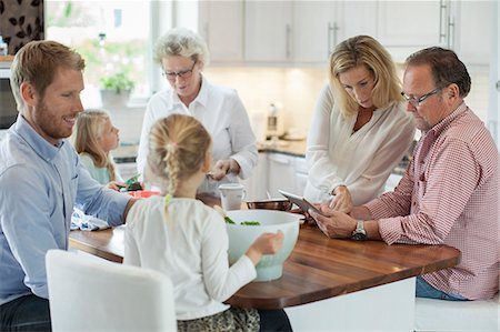 preteen family - Three generation family preparing food in kitchen Stock Photo - Premium Royalty-Free, Code: 698-07587846